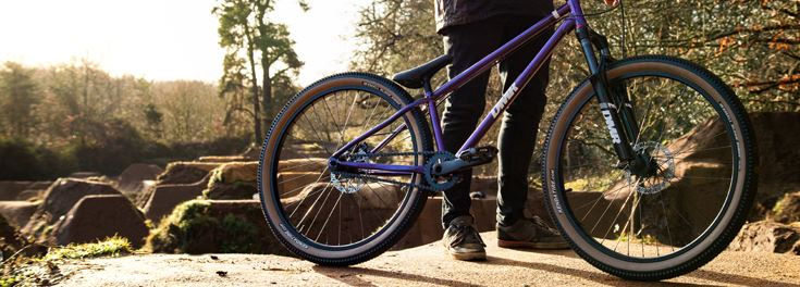 Purple DMR Sect dirt jump bikes and frames